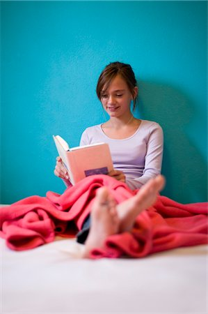 Teenage Girl Reading Book on Bed Stock Photo - Rights-Managed, Code: 700-03333118