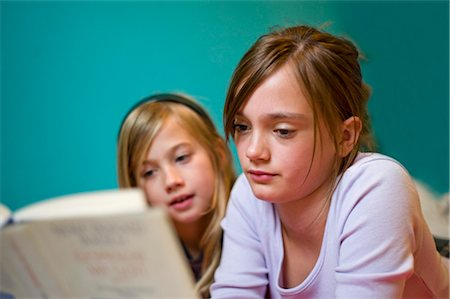 Sisters Reading Book Stock Photo - Rights-Managed, Code: 700-03333120
