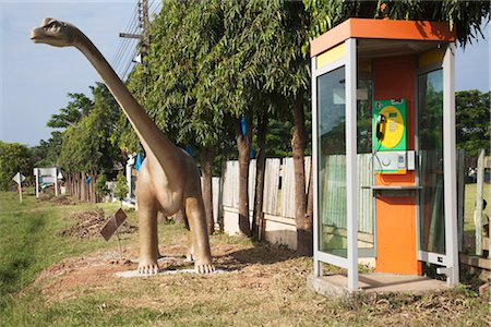quirky - Dinosaur by Phone Booth, Nan, Nan Province, Thailand Stock Photo - Rights-Managed, Code: 700-03368777