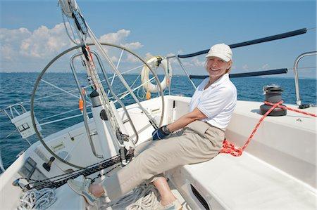 sports and sailing - Captain Adjusting Mainsail on a J109 Sailboat, Lake Ontario, Ontario, Canada Stock Photo - Rights-Managed, Code: 700-03361702