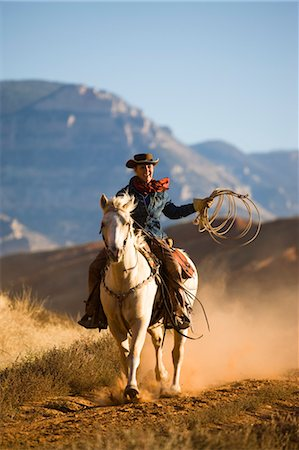 Cowgirl with Rope Riding Quarter Horse, Wyoming, USA Stock Photo - Rights-Managed, Code: 700-03407473