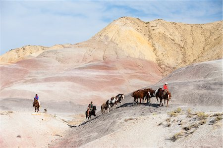 Cowboys Driving Herd of Horses through Badlands, Wyoming, USA Stock Photo - Rights-Managed, Code: 700-03407494