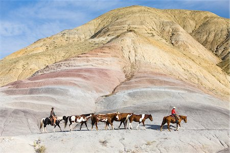 Cowboys Driving Herd of Horses through Badlands, Wyoming, USA Stock Photo - Rights-Managed, Code: 700-03407495
