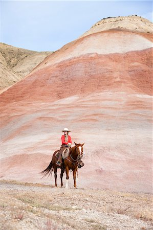 Cowgirl on Horse in Badlands, Wyoming, USA Stock Photo - Rights-Managed, Code: 700-03407493
