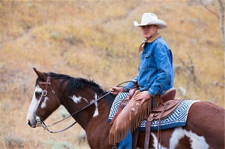 Teenager Riding Horse, Wyoming, USA Stock Photo - Rights-Managed, Code: 700-03407500