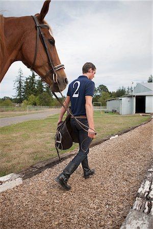 Polo Player Leading Horse, Brush Prairie, Washington, USA Stock Photo - Rights-Managed, Code: 700-03407765
