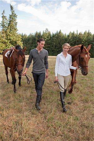 Couple with Horses, Brush Prairie, Washington, USA Stock Photo - Rights-Managed, Code: 700-03407775