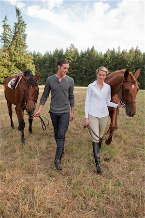 Couple with Horses, Brush Prairie, Washington, USA Stock Photo - Rights-Managed, Code: 700-03407775
