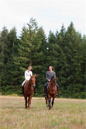 equestrian - Couple Riding Horses, Brush Prairie, Washington, USA Stock Photo - Rights-Managed, Code: 700-03407779