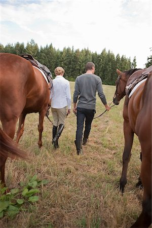 Couple Leading Horses, Brush Prairie, Washington, USA Stock Photo - Rights-Managed, Code: 700-03407773