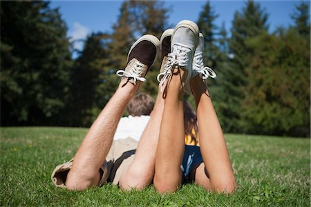Teenage Couple Lying in Grass Stock Photo - Rights-Managed, Code: 700-03407878