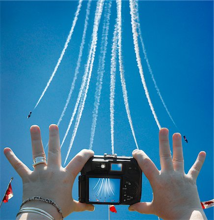 Women's Hands Holding Digital Camera, Taking Picture of Snowbirds at Air Show, CNE, Toronto, Ontario, Canada Stock Photo - Rights-Managed, Code: 700-03403781
