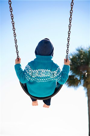 Boy on Swing, Hernando Beach, Florida, USA Stock Photo - Rights-Managed, Code: 700-03439227