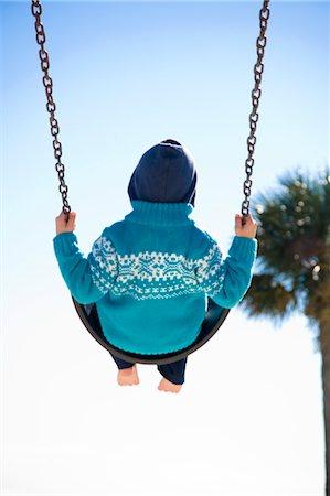 Boy on Swing, Hernando Beach, Florida, USA Stock Photo - Rights-Managed, Code: 700-03439227