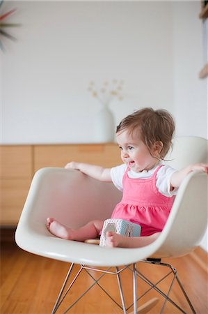 Baby Girl Sitting in a Rocking Chair Stock Photo - Rights-Managed, Code: 700-03439474