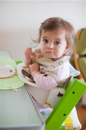 Baby Girl in Her High Chair Having Dinner Stock Photo - Rights-Managed, Code: 700-03439477