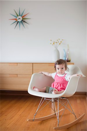 Baby Girl Sitting in a Rocking Chair Stock Photo - Rights-Managed, Code: 700-03439472
