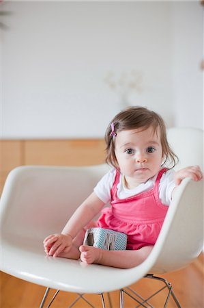 Baby Girl Sitting in a Rocking Chair Stock Photo - Rights-Managed, Code: 700-03439473