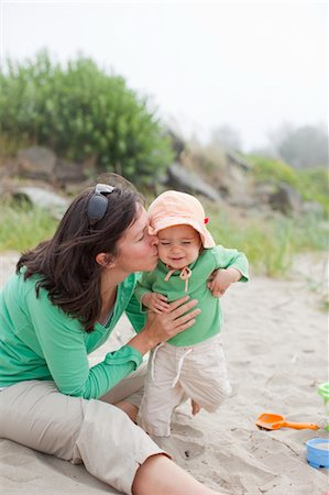 Mother and Baby Daughter Playing in Sand on Beach, Near Seaside, Oregon, USA Stock Photo - Rights-Managed, Code: 700-03439510