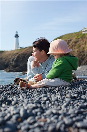 family fun day background - Mother and Baby Daughter Sitting on Beach, with Yaquina Head Lighthouse in the Distance, near Newport, Oregon, USA Stock Photo - Rights-Managed, Code: 700-03439523