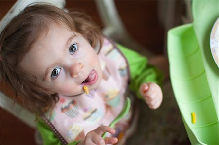 Overhead View of Little Girl Eating Lunch Stock Photo - Rights-Managed, Code: 700-03439544