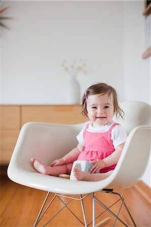 Portrait of Little Girl Sitting in Chair Stock Photo - Rights-Managed, Code: 700-03439552