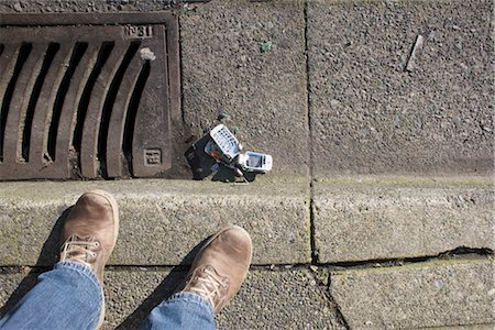 Broken Cell Phone and Feet Stock Photo - Rights-Managed, Code: 700-03439591