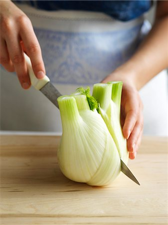 Close-up of Woman Cutting Fennel Stock Photo - Rights-Managed, Code: 700-03439612
