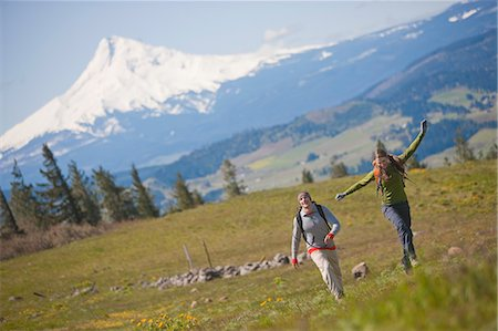 Couple Hiking near Hood River, Mt Hood in background, Oregon, USA Stock Photo - Rights-Managed, Code: 700-03439924