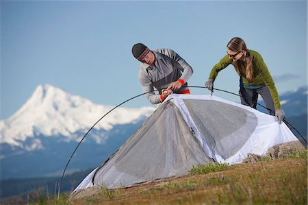 Couple Setting up Tent, Mt Hood in background near Hood River, Oregon, USA Stock Photo - Rights-Managed, Code: 700-03439921