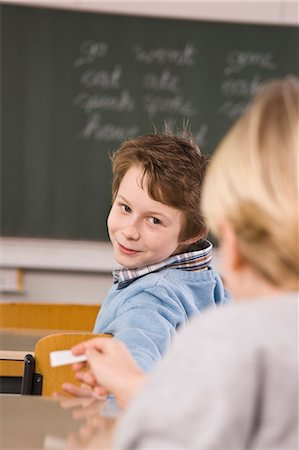 photo of class with misbehaving kids - Students Passing Notes in Class Stock Photo - Rights-Managed, Code: 700-03445058