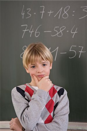 Student Trying to Solve Math Equation Stock Photo - Rights-Managed, Code: 700-03445068