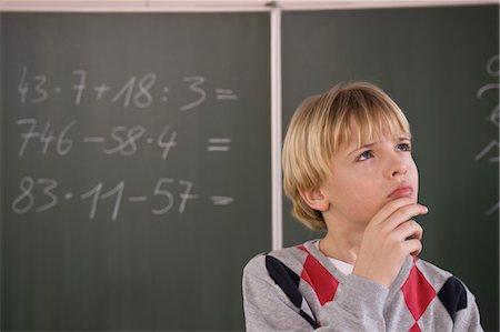 Student Trying to Solve Math Equation Stock Photo - Rights-Managed, Code: 700-03445069