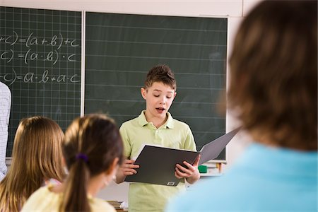 school desk - Student Giving Presentation to Classroom Stock Photo - Rights-Managed, Code: 700-03445103