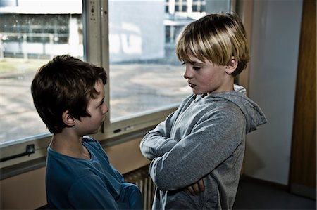 student fighting - Two Students Glaring at Each Other Stock Photo - Rights-Managed, Code: 700-03445136