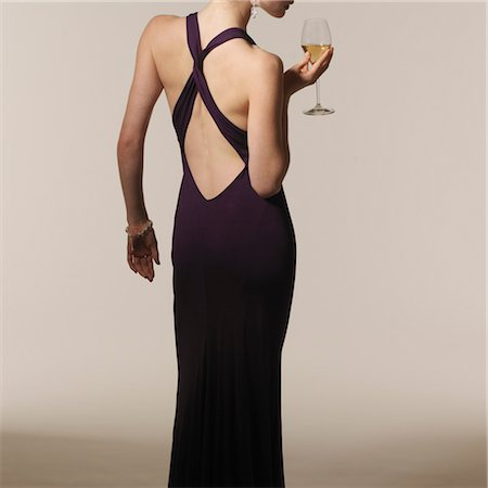 Back View of Woman wearing Evening Gown and holding Glass of Wine Stock Photo - Rights-Managed, Code: 700-03445528