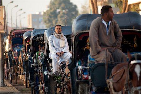 Fiacre Drivers Waiting, Edfu, Egypt Stock Photo - Rights-Managed, Code: 700-03445992