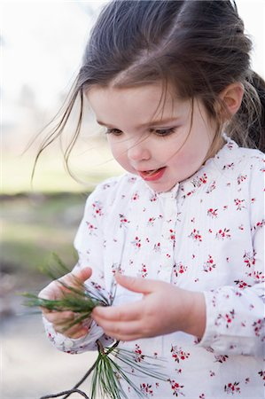 Little Girl Playing Outdoors Stock Photo - Rights-Managed, Code: 700-03446200
