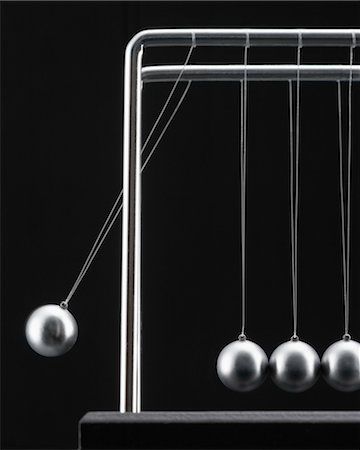 Close-up of Newton's Cradle Stock Photo - Rights-Managed, Code: 700-03448792