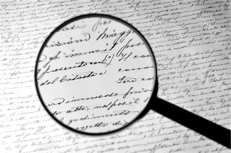Magnifying Glass Englarging Handwritten Document Stock Photo - Rights-Managed, Code: 700-03456359