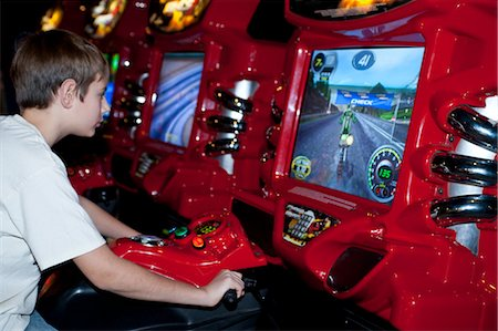 Teenage Boy Playing Arcade Game Stock Photo - Rights-Managed, Code: 700-03456769