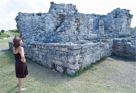 Woman Looking at Mayan Ruins, Tulum, Mexico Stock Photo - Rights-Managed, Code: 700-03456773