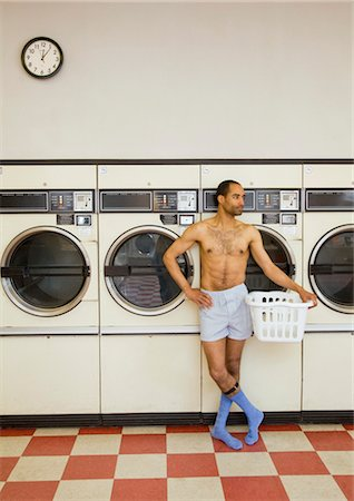 Partially Dressed Man in Laundromat Stock Photo - Rights-Managed, Code: 700-03456967