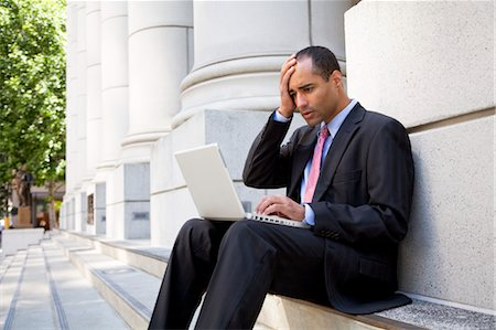 Businessman Using Laptop Outdoors Stock Photo - Rights-Managed, Code: 700-03456963