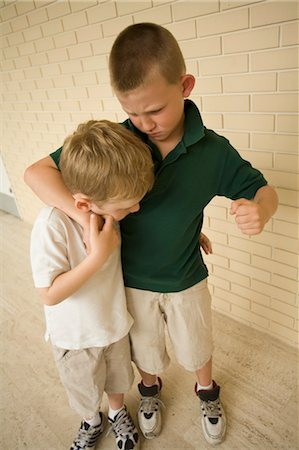 student fighting - Big Boy Bullying Little Boy in School Corridor Stock Photo - Rights-Managed, Code: 700-03458171