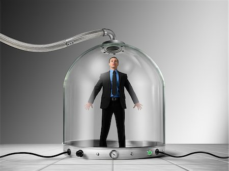 restrained - Businessman Trapped inside of Pressurized Glass Dome Stock Photo - Rights-Managed, Code: 700-03466504