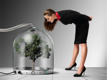 Businesswoman looking at Tree inside Pressurized Glass Dome Stock Photo - Rights-Managed, Code: 700-03466500