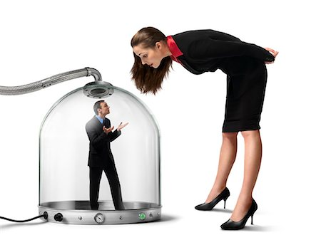 Businesswoman looking at Businessman inside of Pressurized Glass Dome Stock Photo - Rights-Managed, Code: 700-03466503