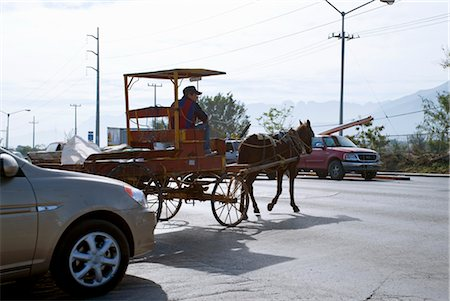 Horse-drawn Carriage on Road, Monterrey, Mexico Stock Photo - Rights-Managed, Code: 700-03466713