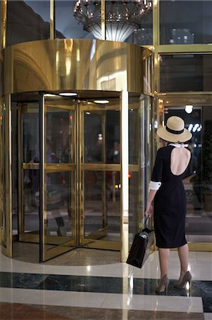 rear - Woman Standing by Revolving Door Stock Photo - Rights-Managed, Code: 700-03478751